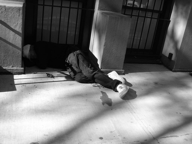 Homeless person sleeping in a doorway. Photo by Dan Dickinson