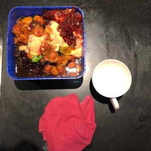 Vegetable scraps, cup and dish cloth