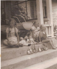 Old Box Brownie snapshot of three girls and their dolls.